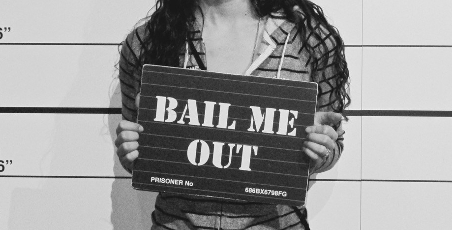 "Composer with sign saying ""Bail me out"""